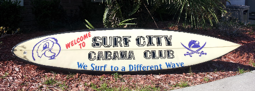 Surf City Surfboard Sign by Lost Bay Designs